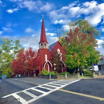 picture of red church and side walk in late summer
